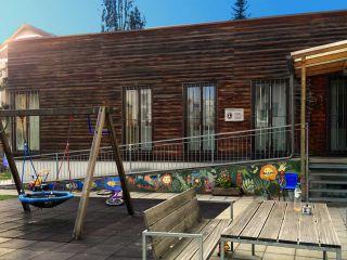 Foto von Frauenhaus und Garten